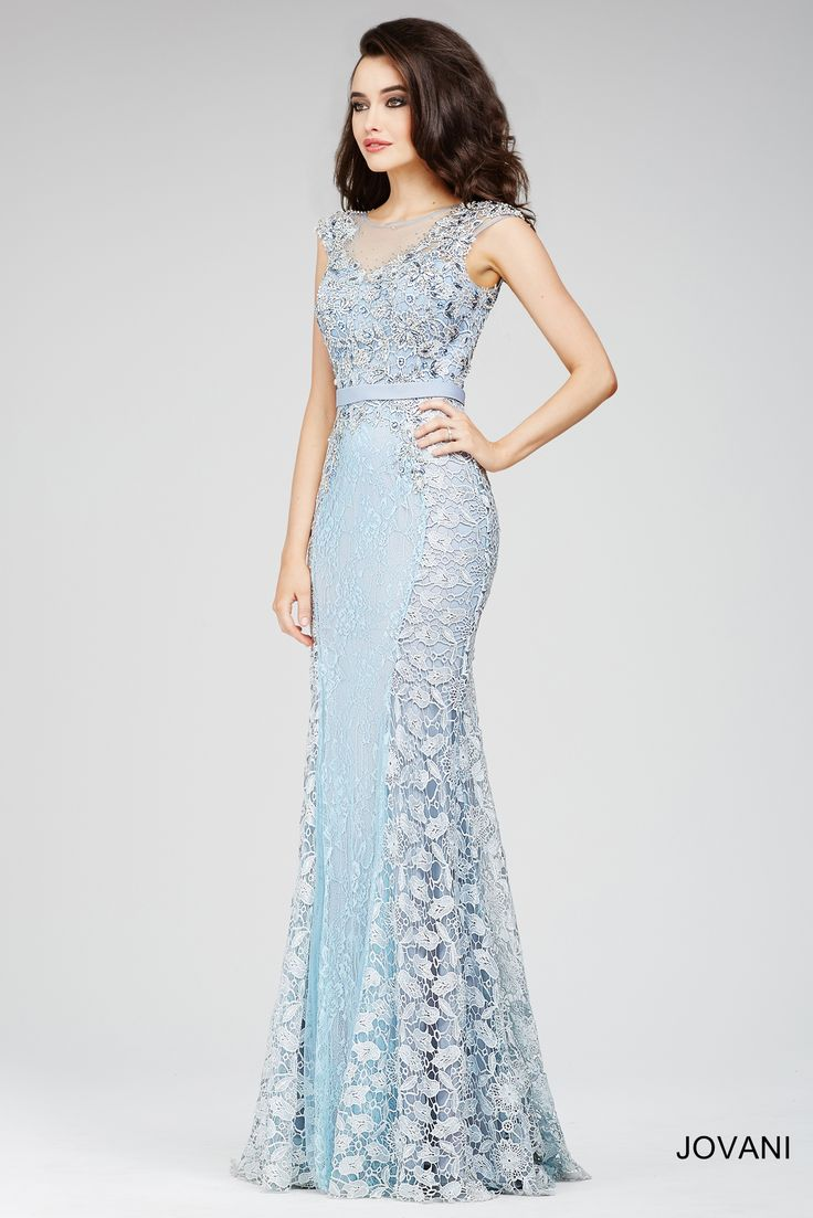 Stunning blue illusion sheath dress features cap sleeves and floral lace pattern