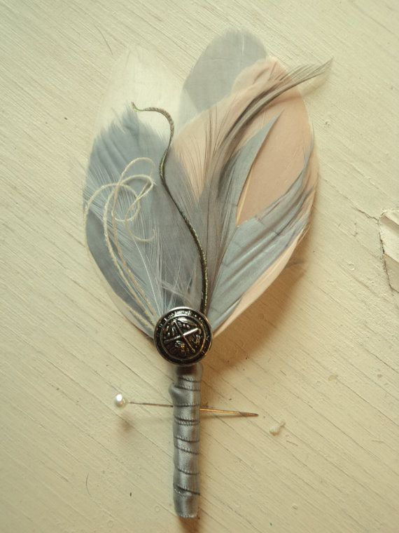 Feather for grooms man n my fiancé. Silver n lil pink feathers. Not the silver thing in centre though.