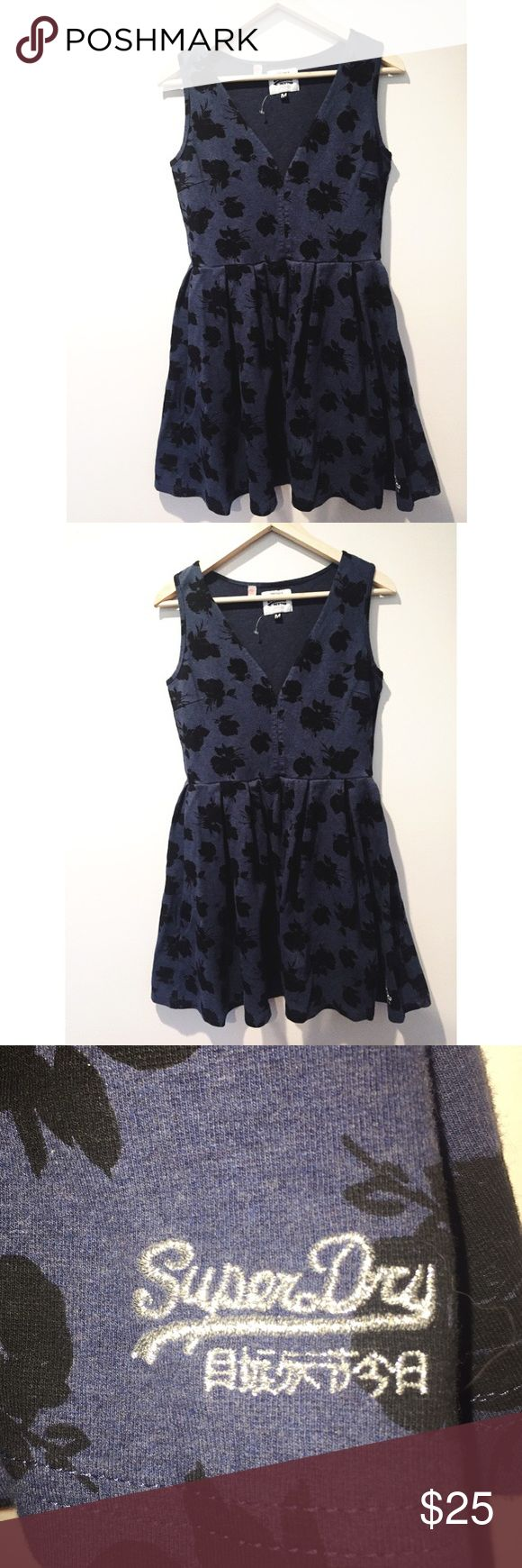 SUPERDRY NAVY V-NECK DRESS W. BLACK FLORAL PRINT Adorable Superdry Navy Sundress W. Black Floral Print! Navy color almost looks like denim but is super light and stretchy - a perfect transition dress from winter into spring and summer!  V-cut front is sexy and compliments the empire waist of the dress. Dress is a size M and can fit sizes 6-8. Pair this with a pair of block and you'll be ready to rock the world! Feel free to reach out if you have any questions 💕☺️ Superdry Dresses