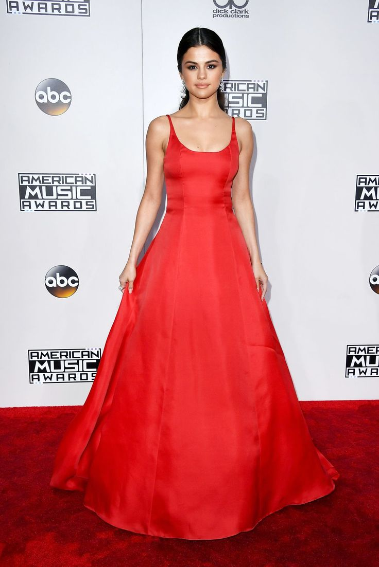 14 Looks That Stood Out At The 2016 American Music Awards #refinery29  http://www.refinery29.com/2016/11/130183/amas-best-dressed-red-carpet-photos-2016#slide-7  Perhaps the best dressed of the evening, Selena Gomez wore a red Prada gown that reminds us of the Calvin Klein number Jennifer Lawrence wore to the 2011 Academy Awards (which happens to be one of our favorite awards show moments of all time). Nice move, Selenita....
