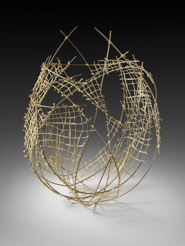 "Jennifer Liston Dykema    Indigenous Elements. Natural reed and raffia. 30""hx22""wx23""d."