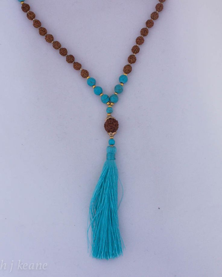 Rudraksha Beads with turquoise stones & blue cotton tassel.Rudraksha beads are thought to have significant & powerful healing properties. According to the ancient Vedas. Rudraksha beads assist in the ability to concentrate, gain clarity & peace of mind, improve memory & relieve stress when worn or held during meditation. https://www.etsy.com/listing/224000356/rudraksha-beads-turquoise-stones-with?