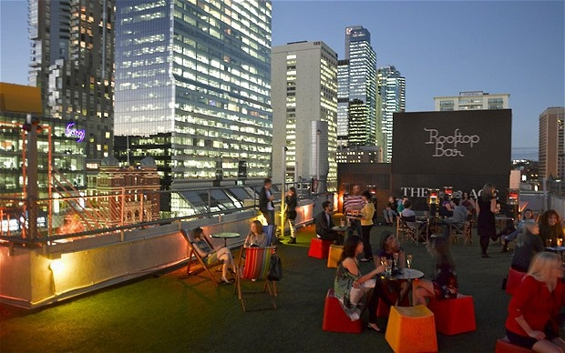 Rooftop Bar & Cinema is located at the top of Curtain House in Swanston Street, Melbourne, which is also home to Cookie bar and The Toff in Town bar. Open from November until March each year, it screens classic films and new hits in the open air, with the city lights creating atmosphere.