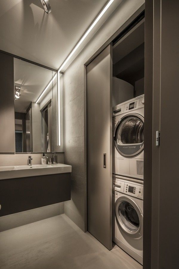 Next to the sink, designers have also managed to hide a washer and dryer behind a clever sliding door for the ultimate in convenience.