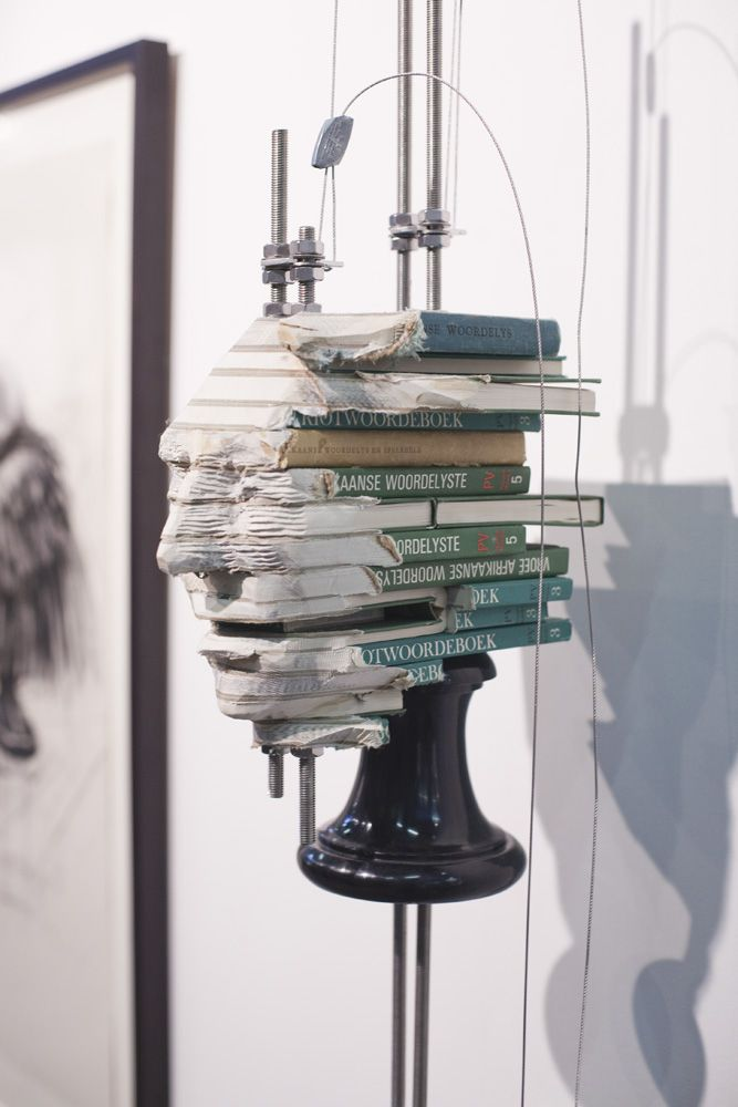 South Africa-based artist Wim Botha. The artist creates sculpture installations out of government and religious texts, reflecting on the human condition.