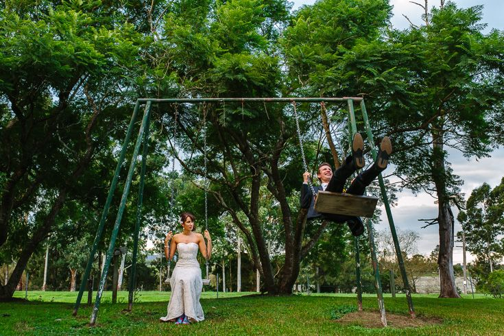 Bride & groom on the swings at the beautiful country homestead venue, Mindaribba House. + gumboots!