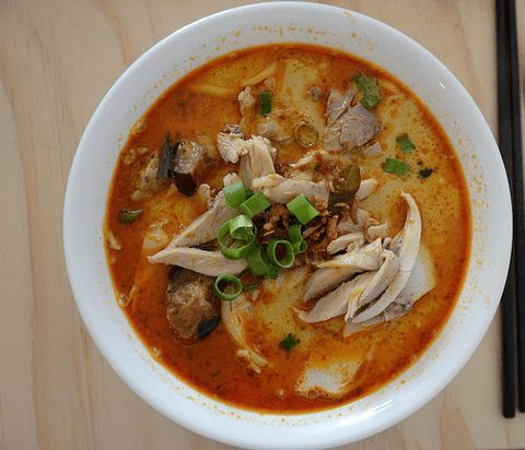 Relish this hot and spicy chicken curry laksa recipe which is flavored with pungent whole spices and fresh coconut milk which gives it a divine flavor.