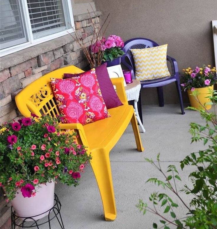 Yellow bench and blue chair plastic garden furniture