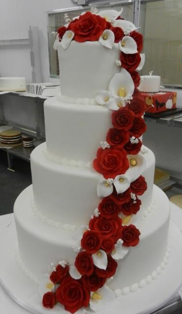 I like this cake too, only maybe the cake a buttercup color with the roses and calla lillies coming down.