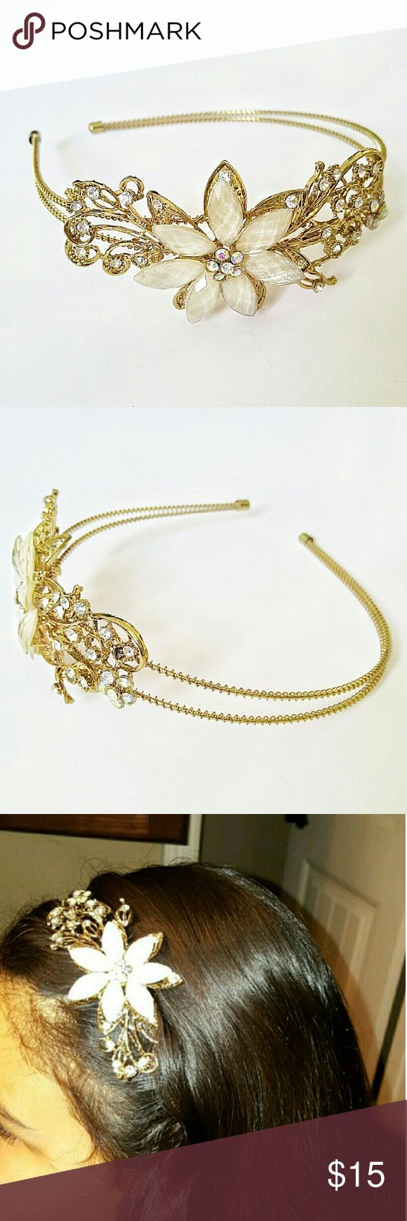 Rhinestone Floral Embellished Gold Headband Breathtaking headpiece! Can be worn for any formal event, date, wedding, bridesmaid as a beautiful finishing touch for your fabulous hair!   Double wrapped wire. Rhinestone scroll accents. Flower centerpiece adorned with ivory faceted stones with a hint of glitter.   Brand New! Never Worn! Accessories Hair Accessories