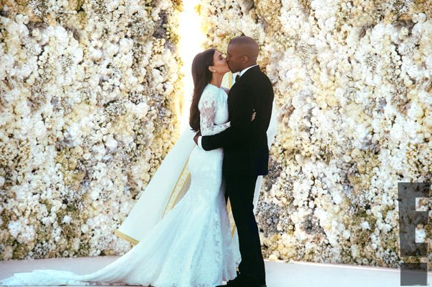 Kimye's wedding: Kim Kardashian and Kanye West get hitched in front of a wall of flowers