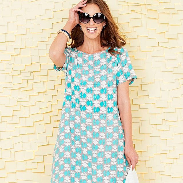 A pretty and simple a line dress with a high low hem and easy style to give it a…