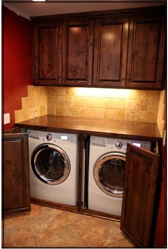 Awesome idea for laundry room! I like the swinging doors concept. We don't have enough room between the window and where the washer and dryer are to frame in bifold shutter doors...