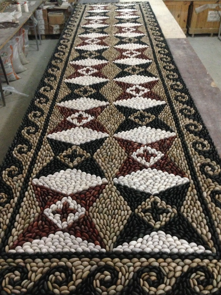 Artistic pebble Mosaic on net. Uses four colours