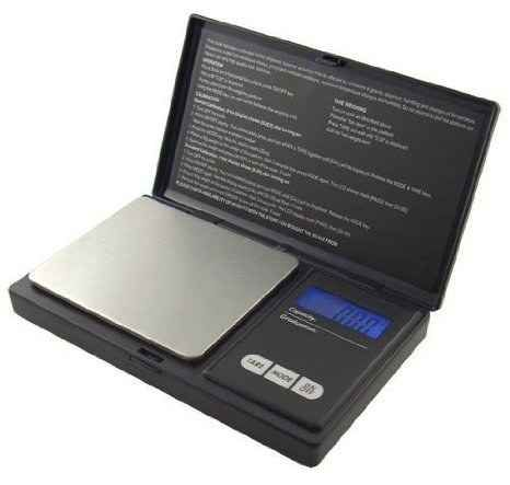 This inexpensive digital scale has .01 g precision ($9.54).