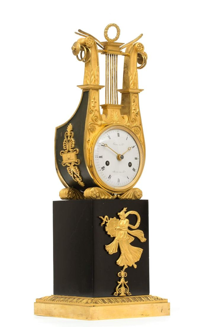 A French Empire ormolu and marble lyre mantel clock by Thomire & Cie, circa 1810.