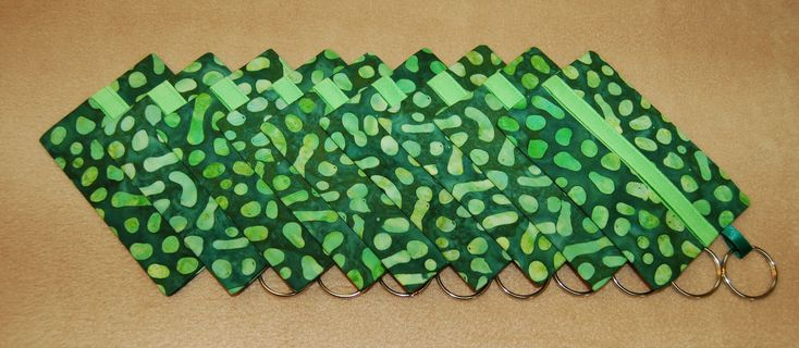 Green spotted batik tissue covers with lime green trim and keyring; set of 9; 1.2.18