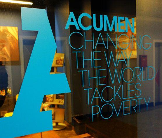 Acumen logo manifestation on office wall by johnson banks www.johnsonbanks.co.uk