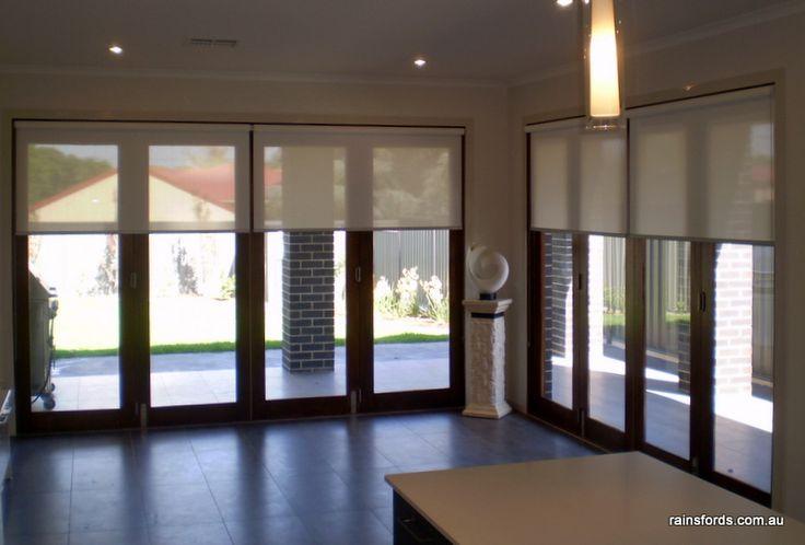 Roller blinds over bi-fold doors by Rainsfords Adelaide  http://rainsfords.com.au/index.php/roller-blinds/#