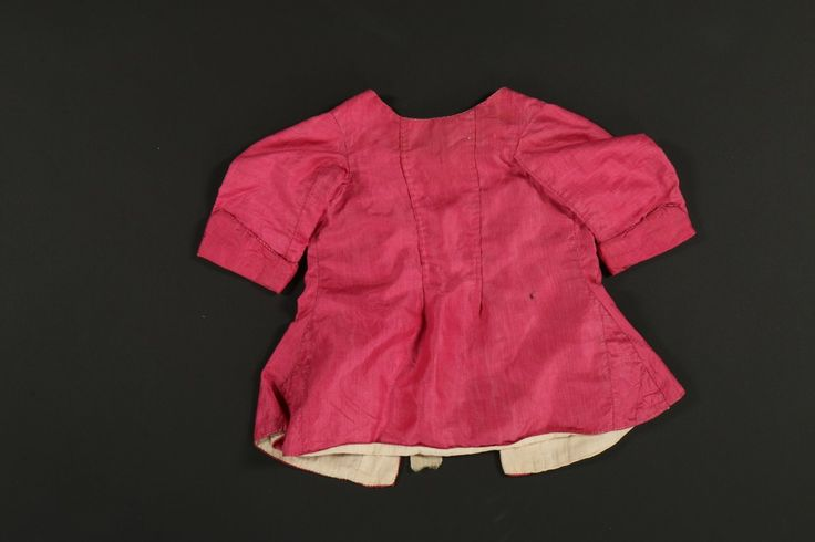 Rear view, infant's jacket, late 18th century. Pale pink silk, yellow silk ribbons, linen lining.