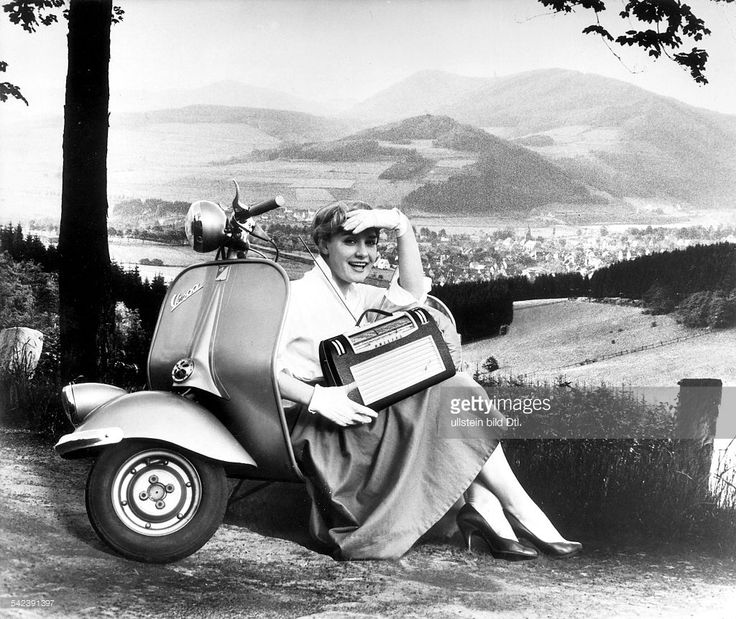 A young girl with a portable radio and a motor-scooter 'Vespa - Piaggio' - 1956
