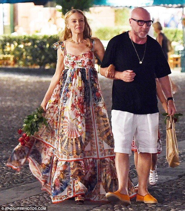 Show-stopper: Heading out for dinner with her close friend Domenico Dolce, Kylie Minogue looked simply stunning in an attention-grabbing floor-length dress which featured a myriad of bright floral prints