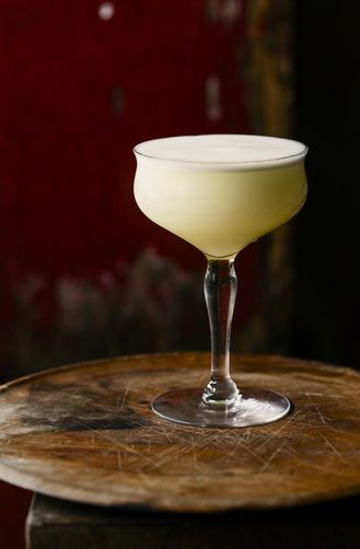 For the White Lady: 1 1/2 ounces London dry gin 1 ounce Thyme-Infused Cointreau 3/4 ounce fresh lemon juice 1 teaspoon double simple syrup (see note) 1/2 ounce egg white Ice cubes 1 orange peel, for garnish