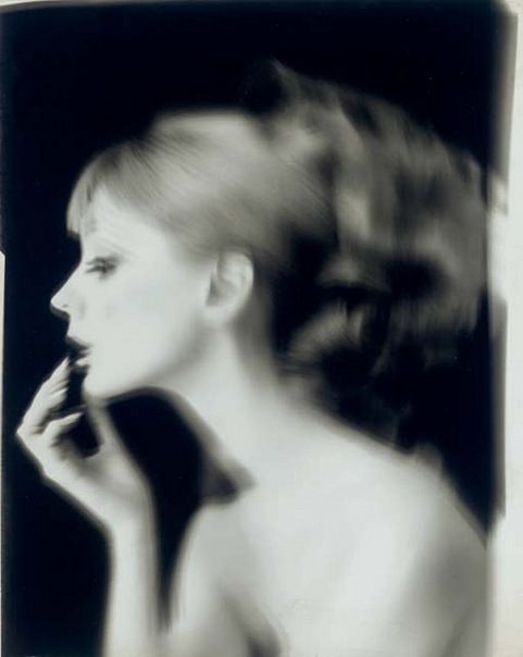 Lillian Bassman Move the camera to get a blur. Pull tripod slightly and then let go. D