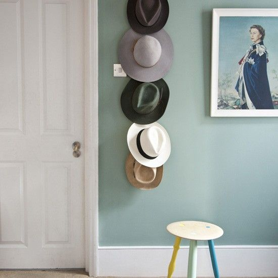 Hats off to whomever thought of this cute idea for displaying your collection! Love the mint wall, too.