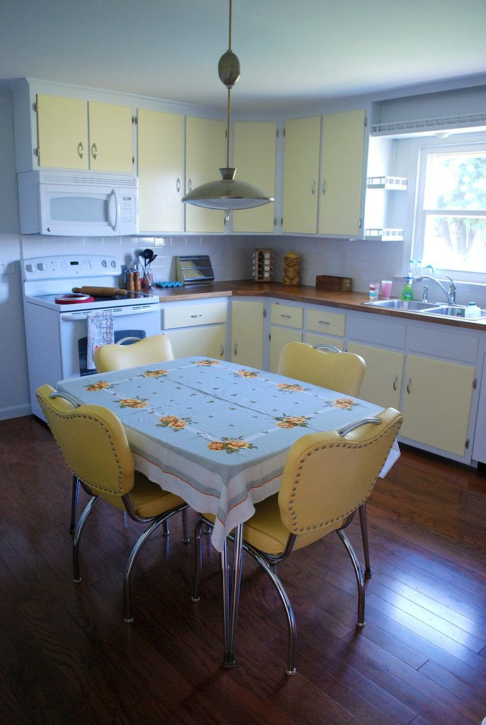 Yellow & white two-tone kitchen cabinets, and vintage-inspired decor