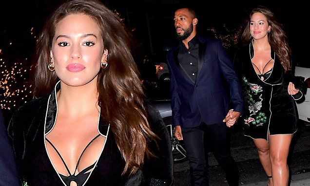 Busty Ashley Graham slips her curves into a daringly low-cut dress