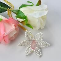 Looking for handmade pearl necklace designs? This article is about a white pearl flower pendant necklace. To know how to make this pearl flower pendant necklace, just keep reading.