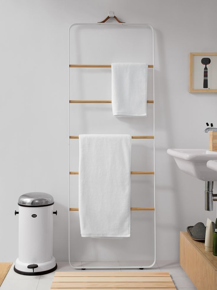 "Towel Ladder Remodelista Materials : Solid oak rails; aluminum frame with powder-coated finish; leather handle. Measurements : H 67"" W 23.5"" D 2"" Product: Towel Ladder Brand: Menu Retailer: Design Within Reach Designer: Norm Architects Color: White"