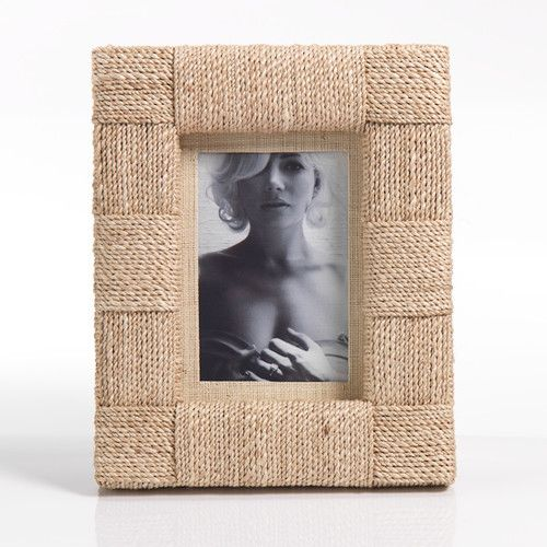 A rope picture frame immediately lends a beachy, natural vibe to a room. | $70