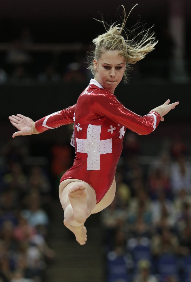 Swiss gymnast Giulia Steingruber performs on the balance beam during the Artistic Gymnastics women's qualification at the 2012 Summer Olympics, Sunday, July 29, 2012, in London. (AP Photo/Gregory Bull)