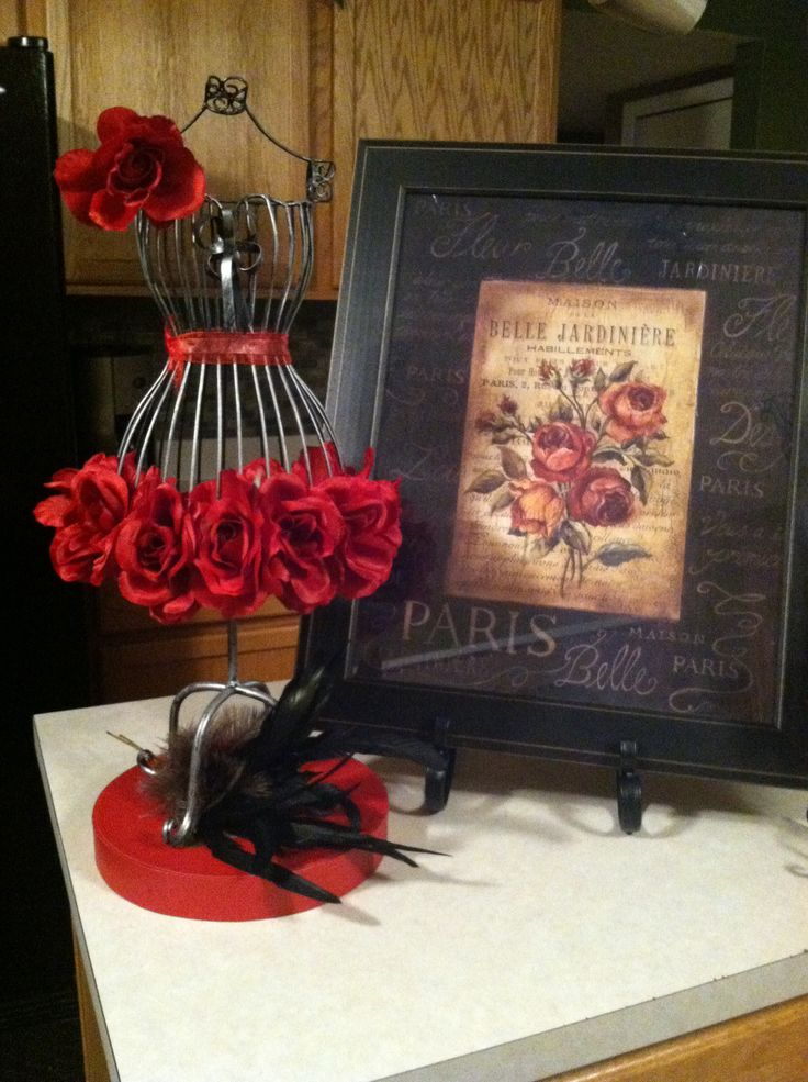 Paris theme centerpiece. Thinking of doing this with white and pink roses