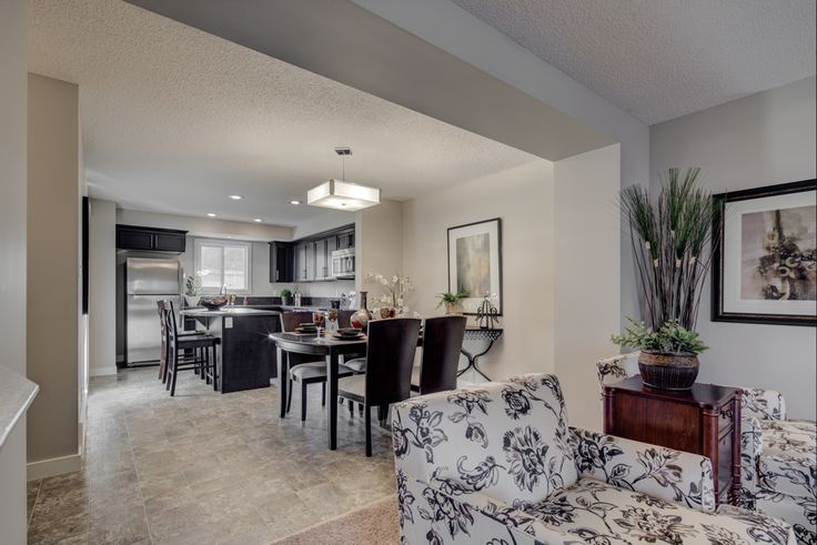 The eating nook separates the kitchen from the living room but you still get an…