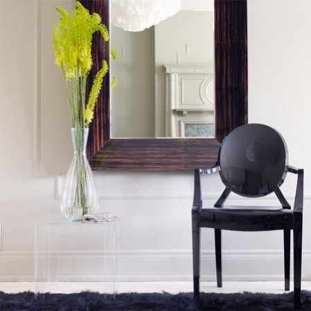 Louis Ghost Chair by Phillippe Starck for Kartell. Clear polycarbonate. Either side of mirrored table