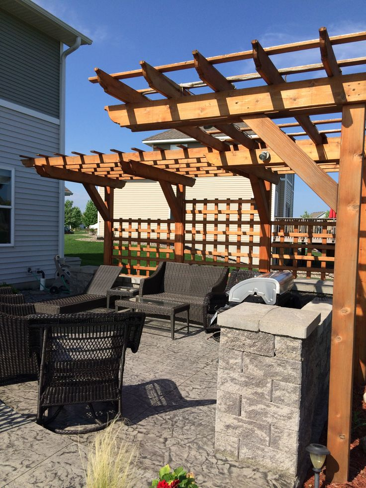 Stamped Concrete Patio With Seating Walls Custom Cantilever Pergola And Planter Box Firepit