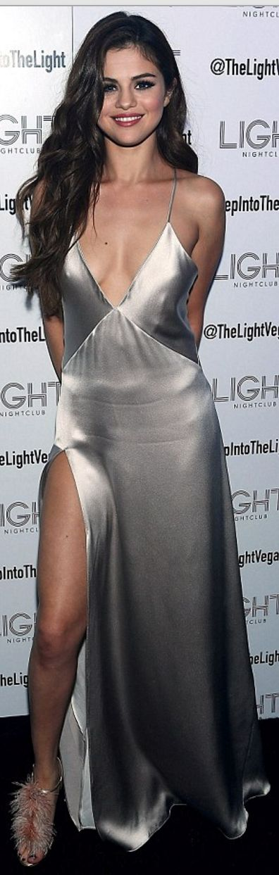 Who made Selena Gomez's silver cut out gown and sandals?