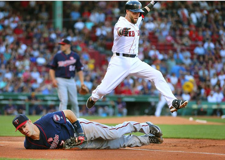 Boston-07/21/2016-Boston Red Sox vs Minn. Twins- Sox Dustin Pedroia leaps over Twins first baseman Joe Mauer after beating the throw after a 1st inning single. Boston Globe staff photo by John Tlumacki(sports)