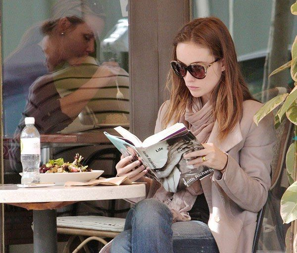 Olivia Wilde reading about Keith Richards.