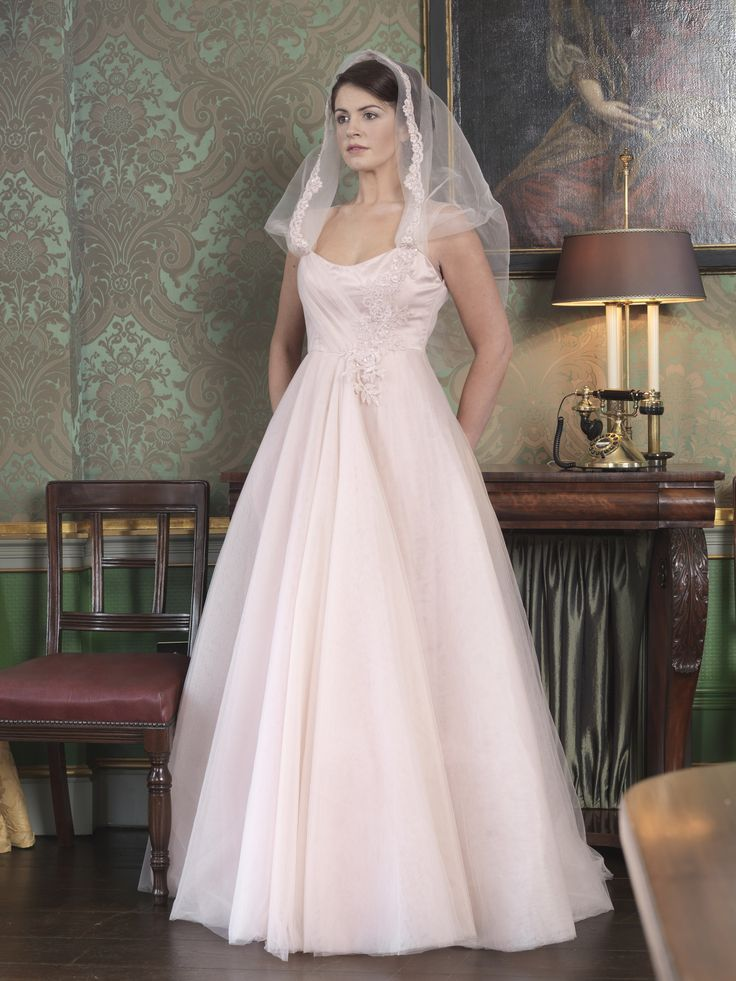 Pink blush, satin tulle wedding dress with beaded lace embellishment on hood and bodice. Inspired by 1960s styling. Taken from 2015 wedding collection by Ginan Abbas. www.goldenstitch.ie