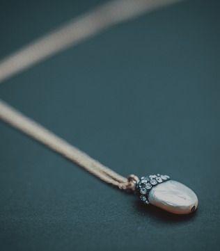 Delicate Pearl Pendant in Silver Chain