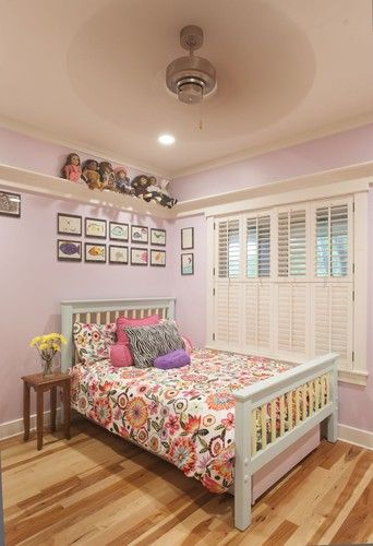 Love the shelf idea around the top of the room...perfect for trophies, ribbons, and all the collectible trinkets little girls come up with. A pain to dust though!!
