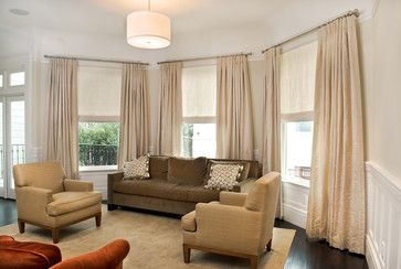 Monochromatic window treatment with inside mount roman shades for tall windows.