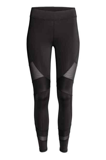Pantaloni sportivi: Pantaloni sportivi in tessuto tecnico ad asciugatura rapida. Alta fascia di maglina con effetto contenitivo e modellante in vita. Taschina portachiavi in mesh nascosta nel girovita.