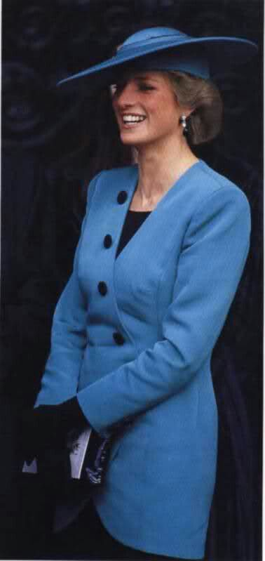Princess Diana wearing a deep turquoise Catherine Walker jacket in the crossover style w/ decorative buttons they used frequently. This was made for a wedding.