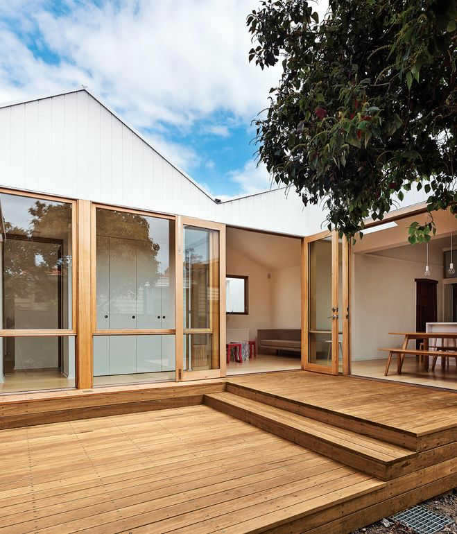 The addition is clad in grooved painted plywood and the new deck is made from blackbutt wood, the sort used for wharves.