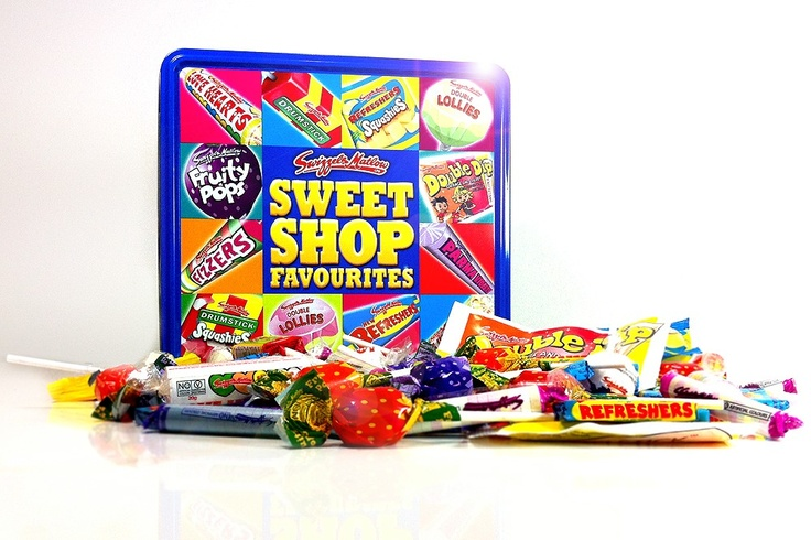 This bright retro tin contains an assortment of Swizzle Matlow all time favourite sweets and lollies, contents vary but include Drumstick Lollies, Fizzers, Parma Violets, Fruity Pops, Double Lollies, Refresher Squashies, Love Hearts and Double Dip. 750g of all your favourites    Includes free personalised gift card - featuring your own personal message / All our products will arrive in a white secure box which will be gift wrapped.